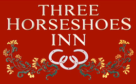The Three Horseshoes logo near Hay-on-Wye.